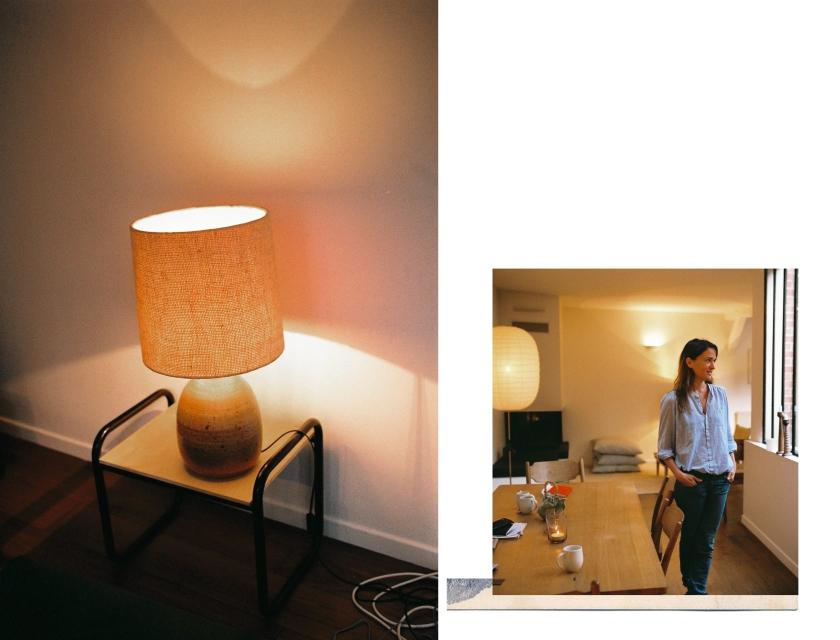 Détail d'une lampe et silhouette de Victoire dans sa salle à manger
